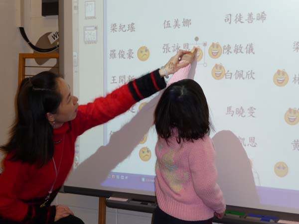 Young girl learning Chinese in the classroom.