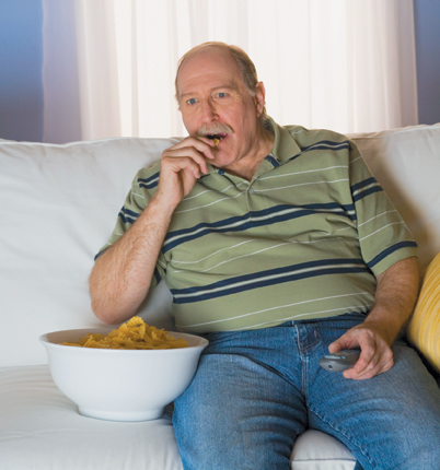 man eating from bowl